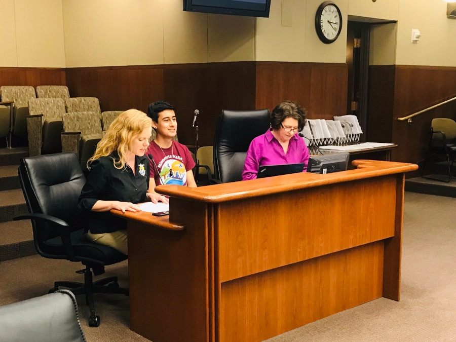 "Sarena Selbo (left), Oscar Hernandez (middle), Deb Loon (right) present the ""Mentoring the Next Generation of Conservation Professionals"" proposal to the Minnesota State Legislature overseeing the LCCMR fund."